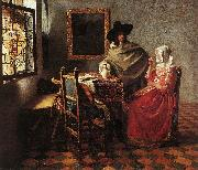A Lady Drinking and a Gentleman wr VERMEER VAN DELFT, Jan