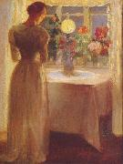 Young Girl Before a Lit Lamp Anna Ancher